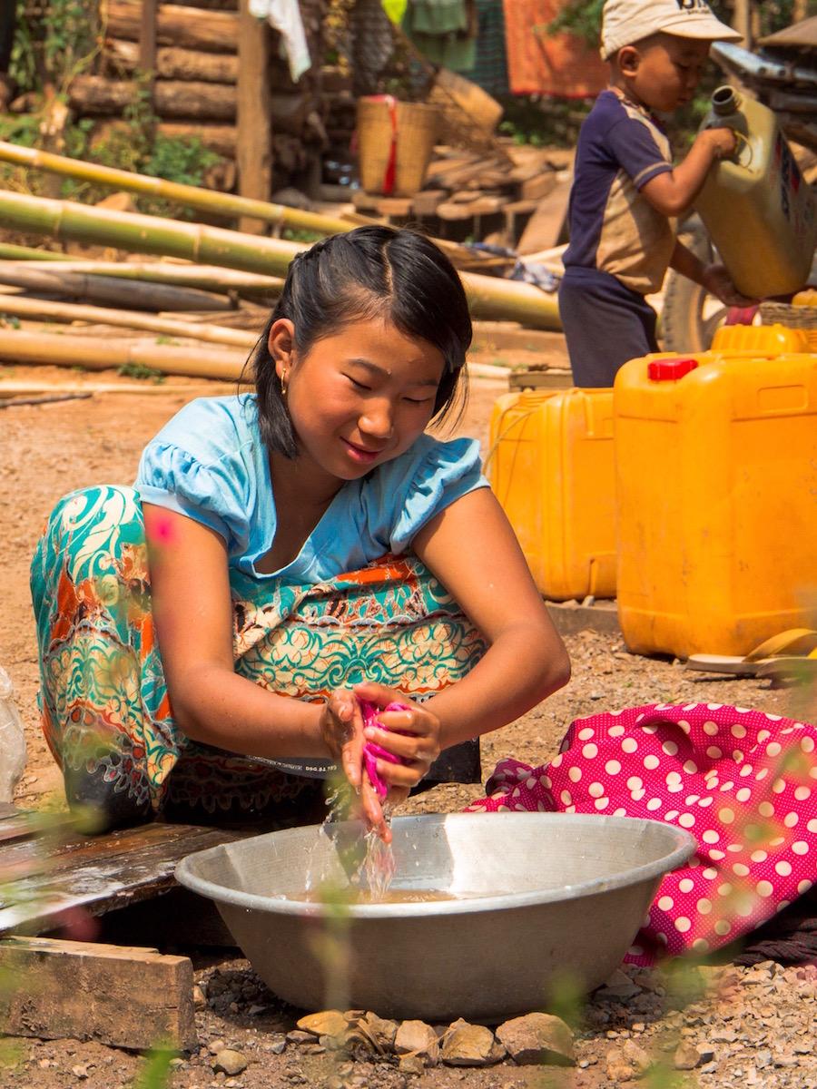 Myanmar girl washing clothes Portrait