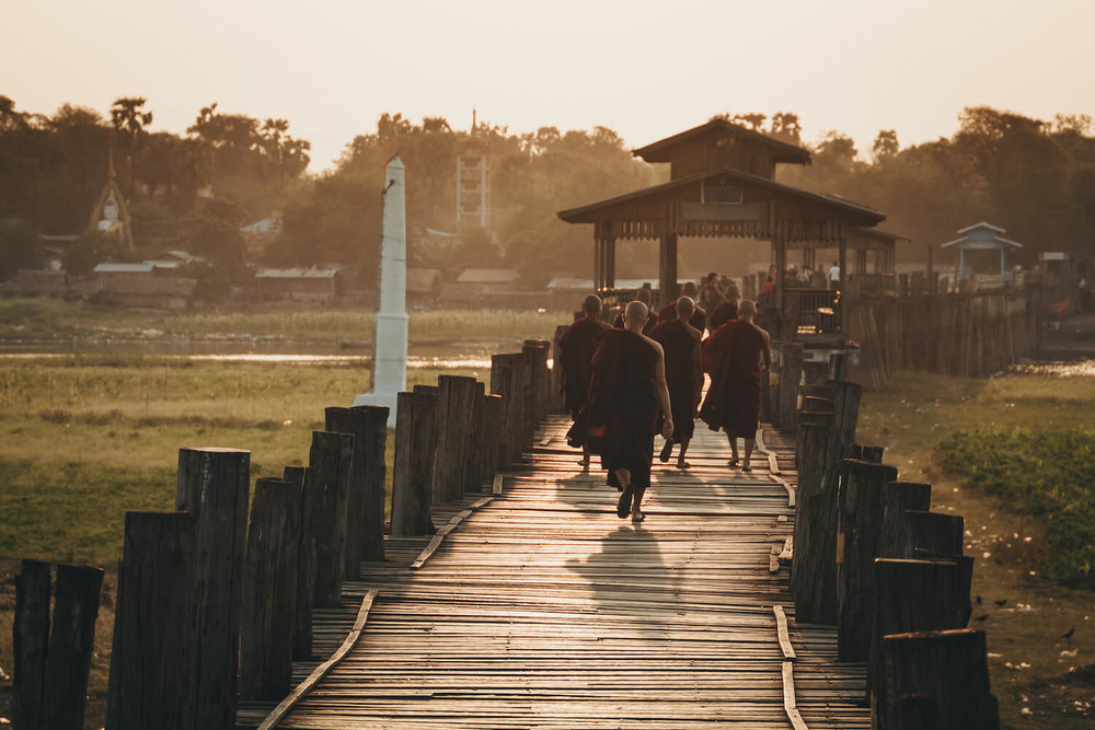 Photo from Ubein Bridge, a Unesco World Heritage site in Myanmar, and the oldest and longest teak wood bridge in the world. Photo from Ubein Bridge, a Unesco World Heritage site in Myanmar, and the oldest and longest teak wood bridge in the world. Monks walk along the bridge across Taungthaman Lake near Amarapura to prayer. #Myanmar #Burma #Buddhism #Travel #Photography
