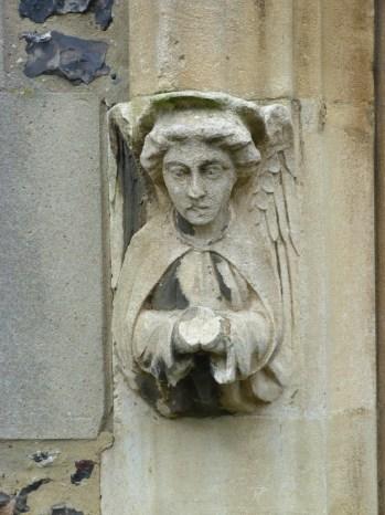 3 - Carved stone figure of angel on door frame