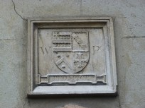 3 - William Patten's initials and coat-of-arms (above entrance)
