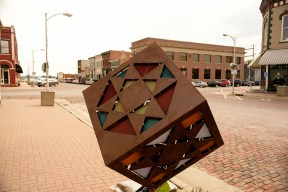 """Sculpted pieces dot the """"landscape"""" downtown in Woodbine, Iowa Friday, June 16, 2017. (photo by Jerry L Mennenga©)"""
