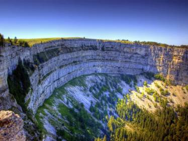 The creux du van is a natural amphitheatre in the Cantons of Neuchâtel and Vaud.