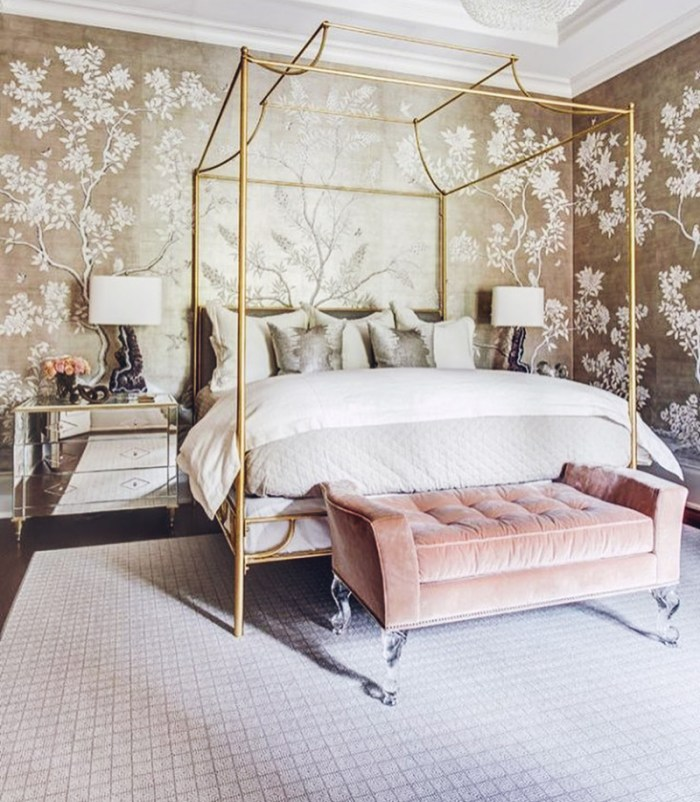 Feminine glam traditional bedroom with gold canopy bed