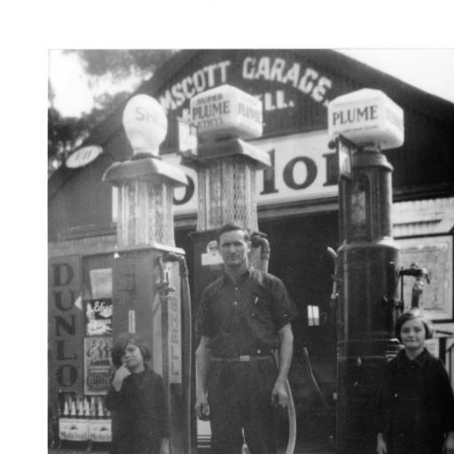 H Newell and children in front of Kelmscott Garage, ca 1940 petrol
