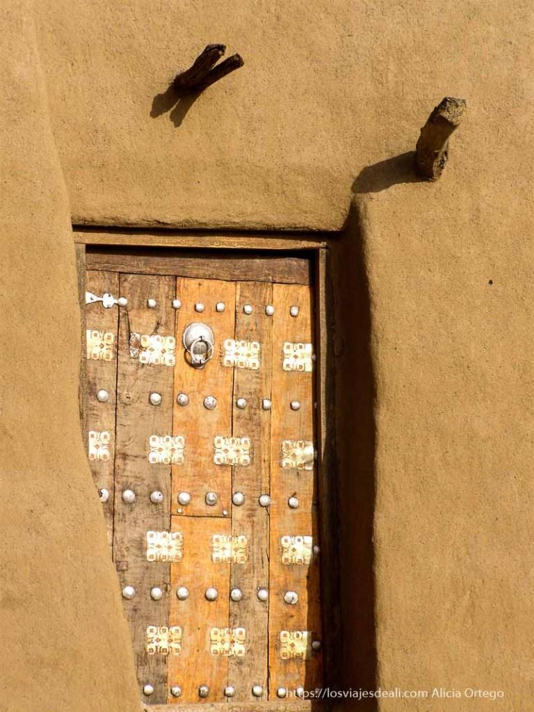 puerta ornamentada de tombuctú