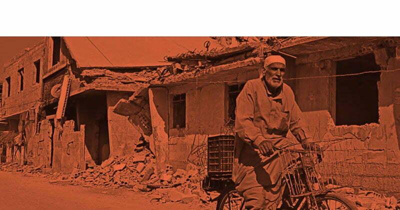 calle de Bagdad con hombre de barba blanca en bicicleta vieja con cesta delante y detrás y casas bombardeadas uno de los relatos y novelas de viaje