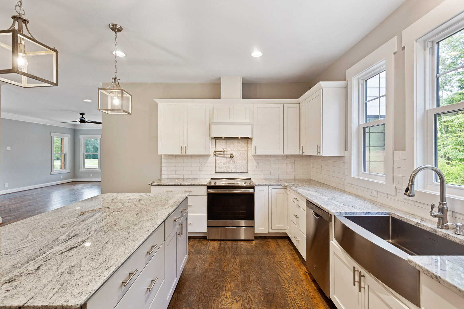 White kitchen of Balsom 1, with pot filler, deep sink, and granite countertops