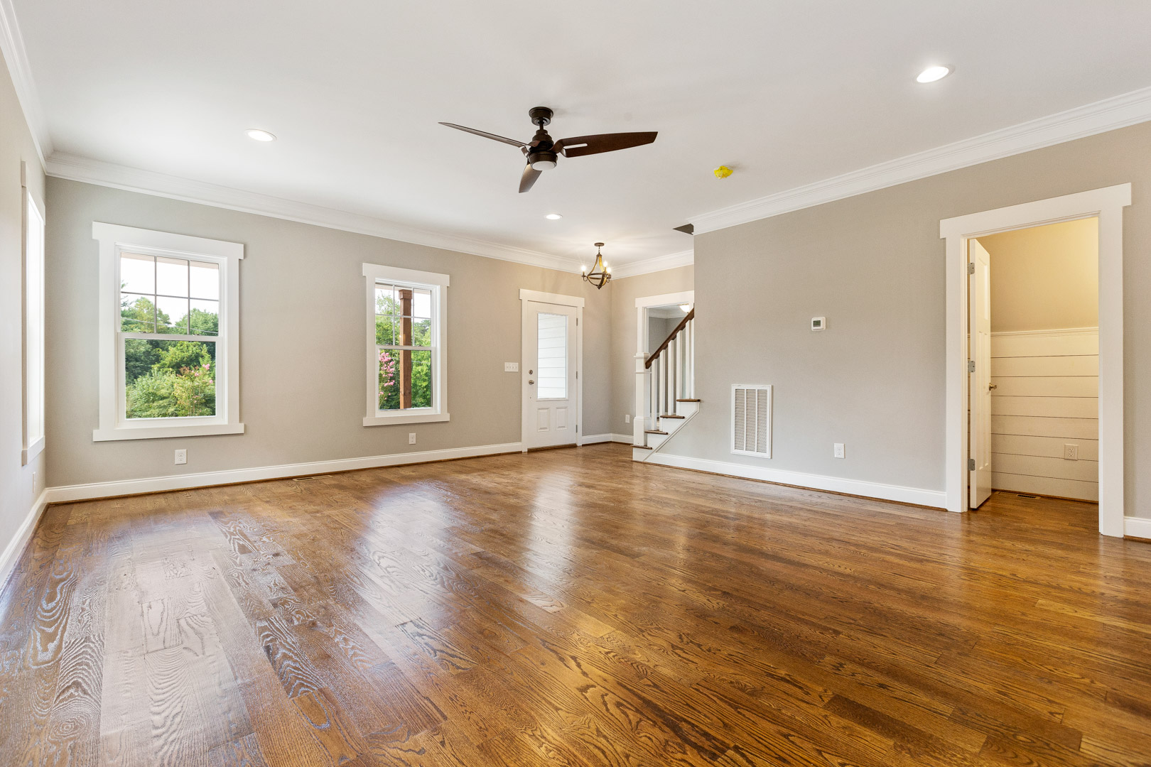Hardwood floors and clean design of Balsom living room