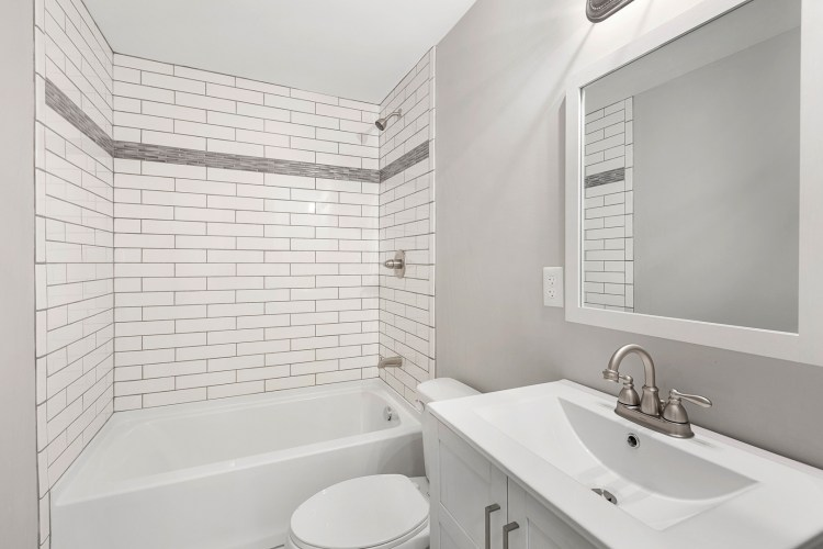 Updated bathroom with subway tile and new vanity