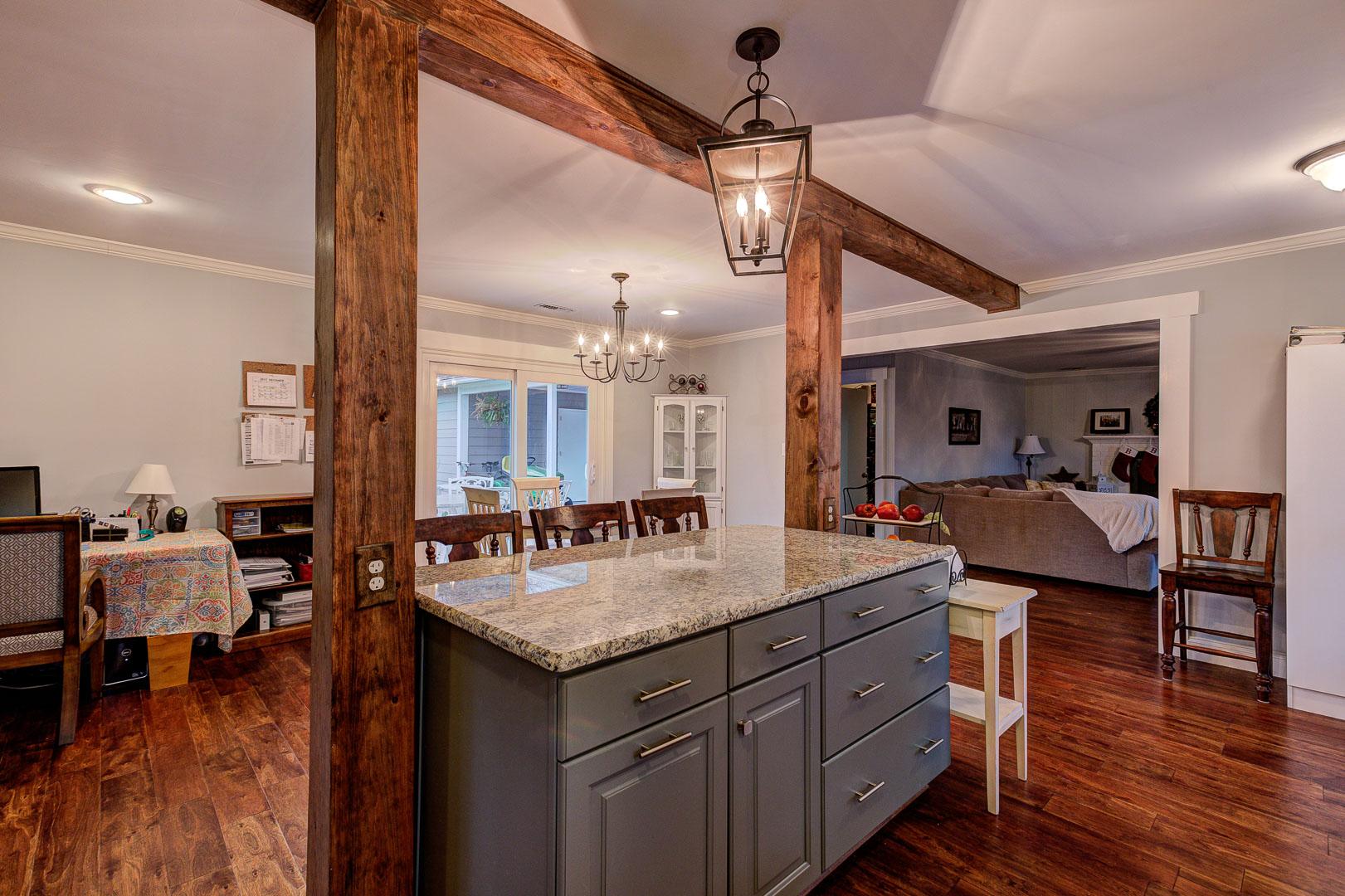 Custom kitchen island with rustic wood beams