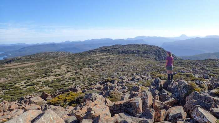 Female hiker looks across to the Overland Track