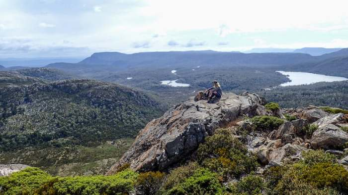 male hiker looks at view from mount jerusalem