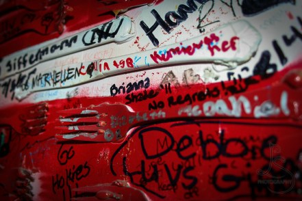 """Silverware glued to the wall and painted in red and white, then graffitied with names of visitors to this local Chicago pizza joint - including my mantra of """"no regrets"""" 