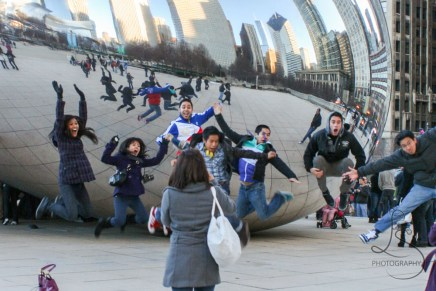 People jumping in front of The Bean in Chicago | LotsaSmiles Photography
