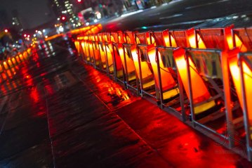 These construction cones light the avenue in Tokyo.