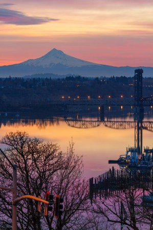 The Willamette River gently wakes up in the shadow of Mount Hood.