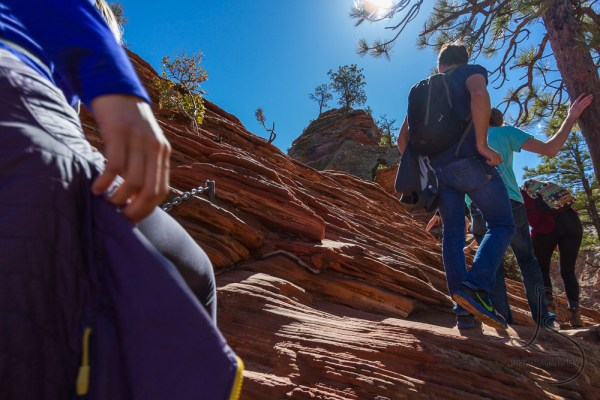 People ascending the Angels Landing trail, backlit by the sunny afternoon | LotsaSmiles Photography