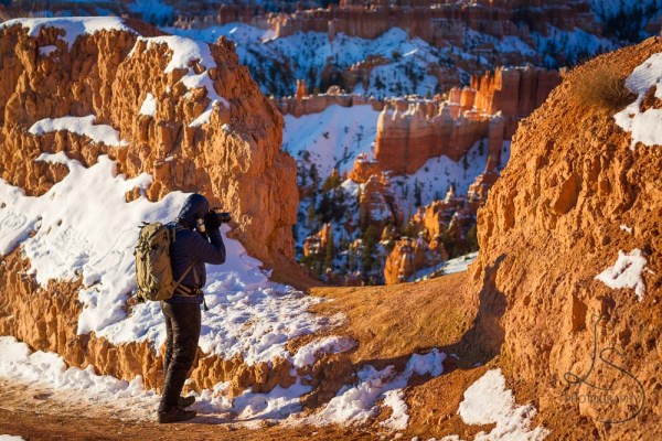 A fellow photographer shooting Bryce Canyon in the distance | LotsaSmiles Photography