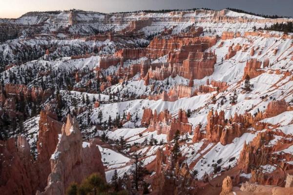 Snowy hoodoos in Bryce Canyon at sunrise | LotsaSmiles Photography