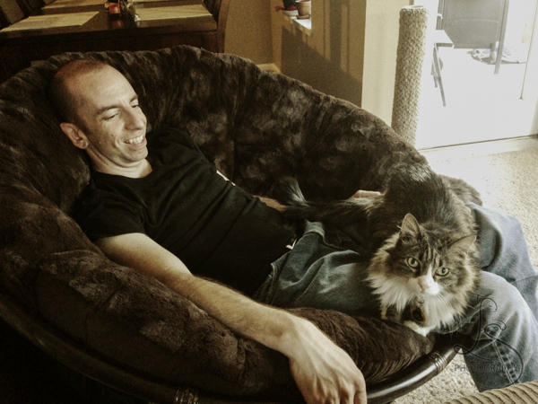 Zoe lounging on Aaron's lap while he reclines in the papasan | LotsaSmiles Photography