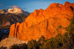 Garden of the Gods's Kissing Camels and Pikes Peak are illuminated by the early Colorado sun.