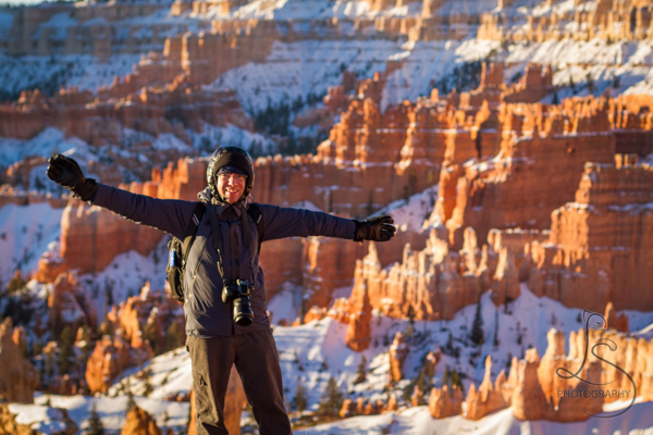 Aaron posing in front of the snowy hoodoo landscape of Bryce | LotsaSmiles Photography