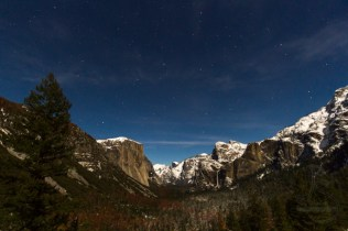 A full moon illuminates Yosemite Valley in the winter.