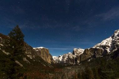 A full moon illuminates Yosemite Valley in the winter.