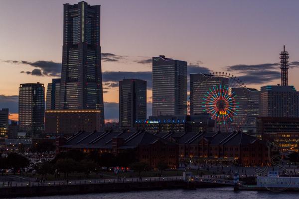 The Yokohama skyline just after sunset, with lights illuminated | LotsaSmiles Photography