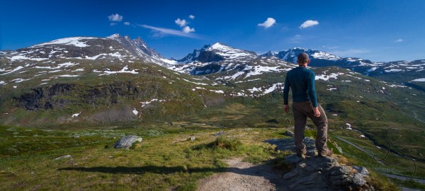 Aaron taking in the magnificent mountain view of Norway | LotsaSmiles Photography