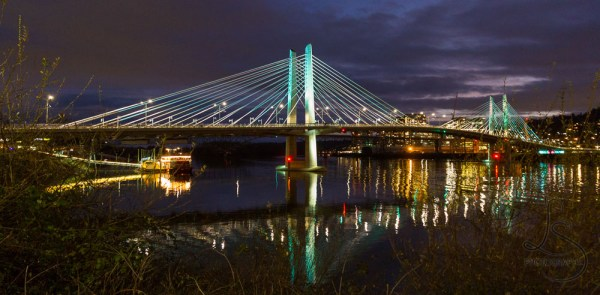 The illuminated Tilikum Crossing in Portland at night | LotsaSmiles Photography