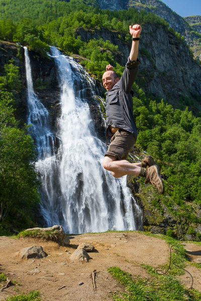 Aaron jumping in front of Brekkefossen in Norway | LotsaSmiles Photography