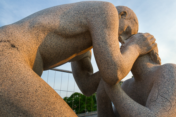 Two statues with foreheads touching in Vigeland Park   LotsaSmiles Photography