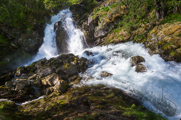The upper falls behind the primary Brekkefossen fall | LotsaSmiles Photography