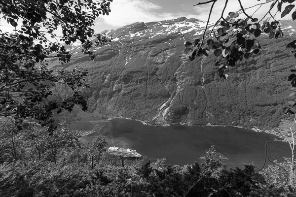 The first views of the water of Geiranger Fjord as a cruise ship passes by, in monochrome | LotsaSmiles Photography