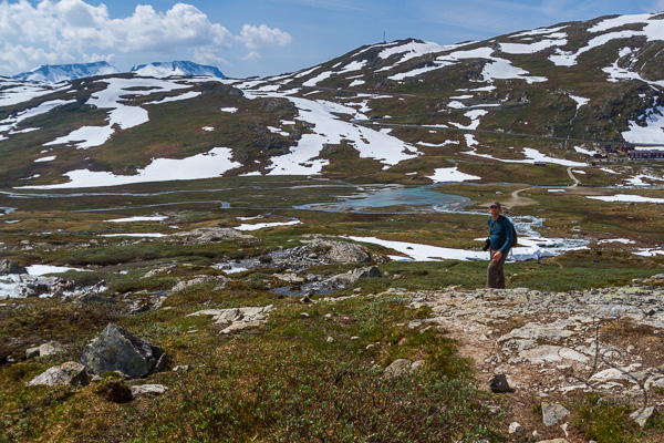 Aaron at the final ridge, with our starting point in sight | LotsaSmiles Photography