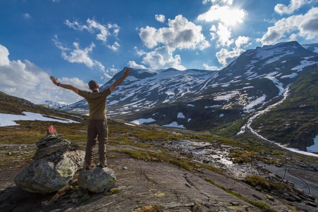 Aaron enjoying the view along the trail above the Trollstigen viewpoint in Norway | LotsaSmiles Photography