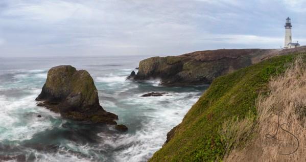 Waves crash against the shore at the Yaquina Lighthouse near Newport, Oregon   LotsaSmiles Photography