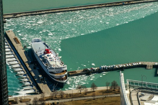 A boat in the Chicago Harbor, surrounded by thin ice | LotsaSmiles Photography
