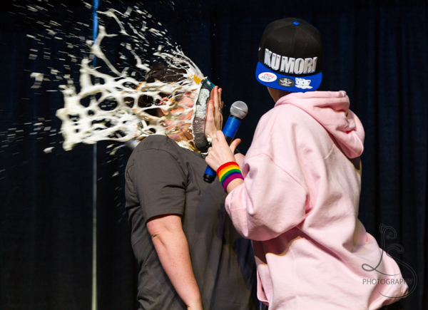 Sam Taylor takes a cream pie to the face from musician Cieran Strange at Kumoricon 2018 | LotsaSmiles Photography