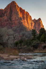 The sun sets over Zion's Watchman rock formation