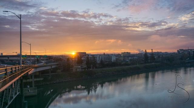 The sun rising over the Eastbank Esplanade in Portland   LotsaSmiles Photography