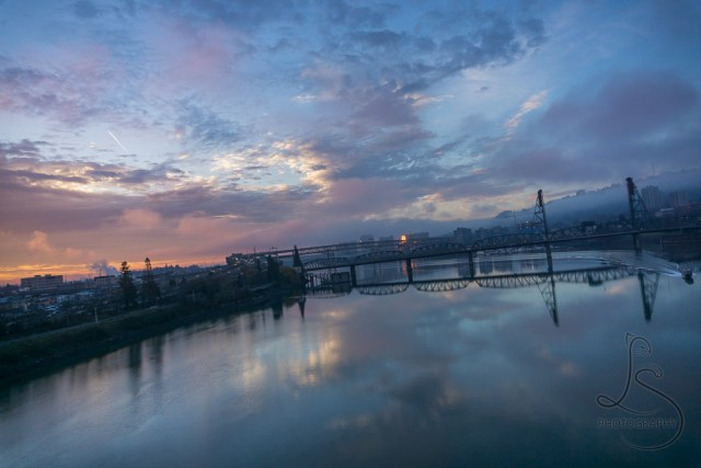 Boat disturbing the still waters of the Willamette in front of Portland at dawn | LotsaSmiles Photography