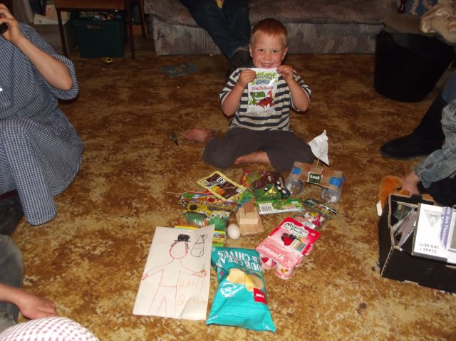 This little boy had a birthday!  He was showered with gifts, and of course loved the attention!