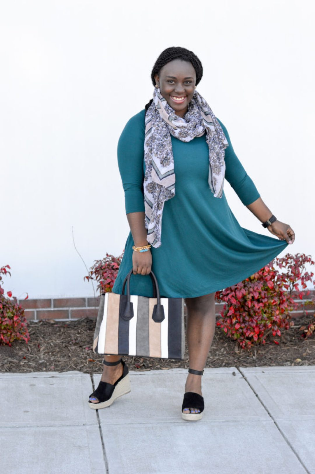 Teal top with wedges and stripped purse