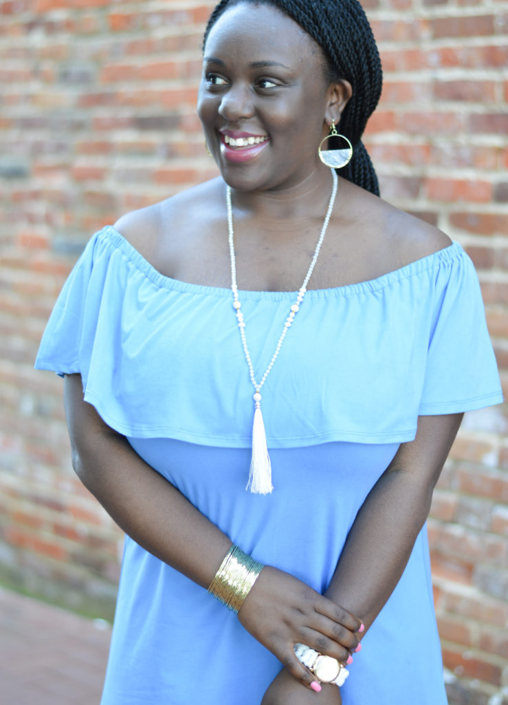 Styling an OTS dress with statement jewelry