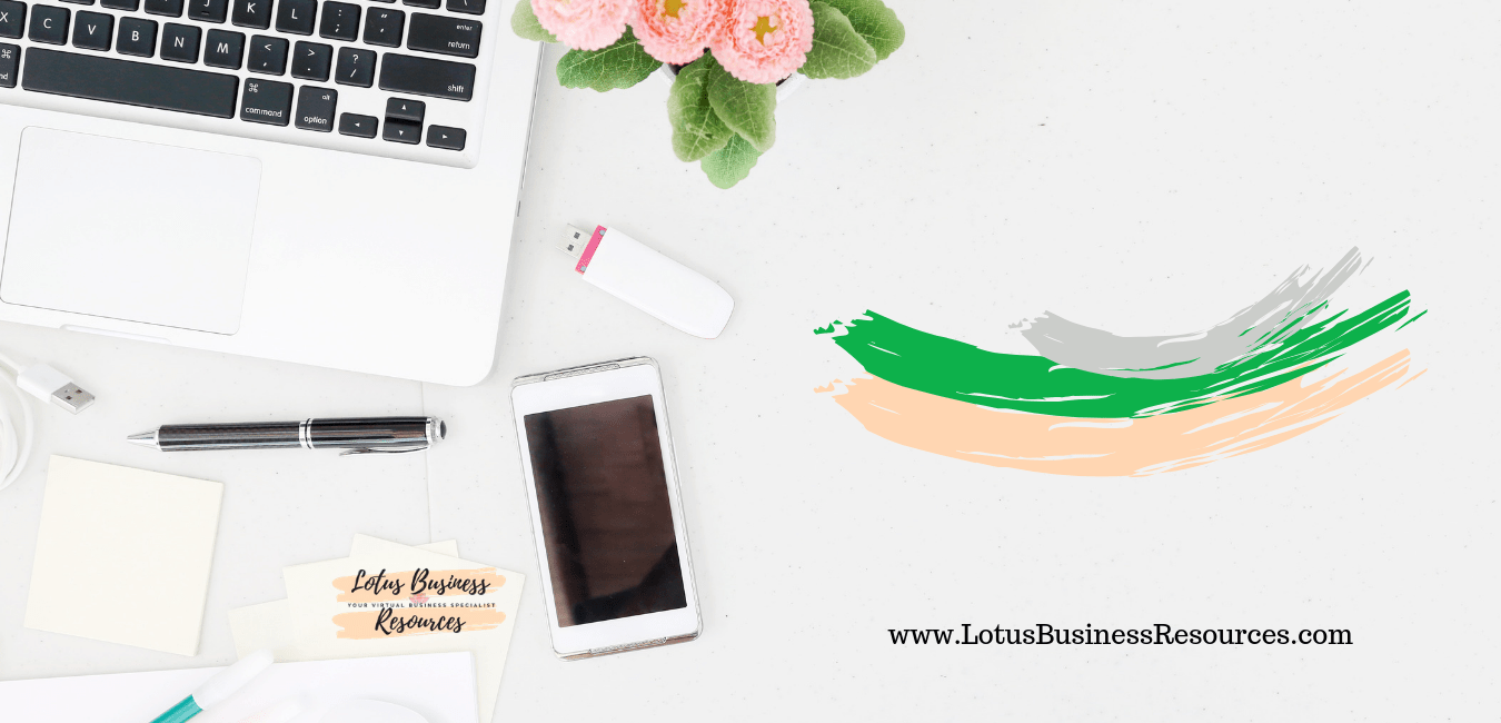 Desk with laptop, usb, pen and cellphone with Lotus Business Resources logo and URL