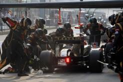 Kimi Raikkonen, Lotus E21 Renault, in the pits.
