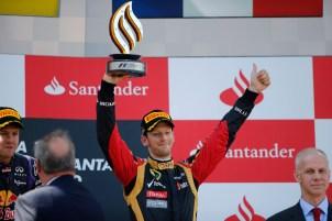 Romain Grosjean, Lotus F1, 3rd position, lifts his trophy on the podium