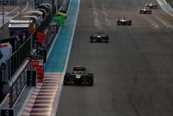 Romain Grosjean, Lotus E21 Renault, leads Lewis Hamilton, Mercedes W04, and Nico Hulkenberg,